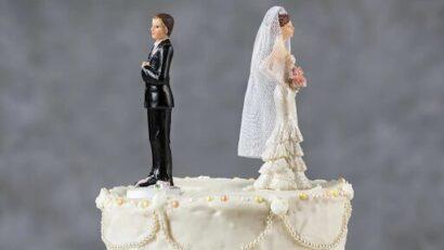 صورة لمجسمات ل عروس و عروسة فوق قالب الكاتو