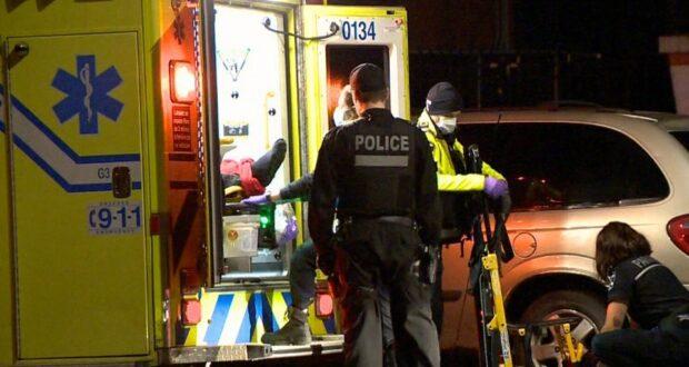 صورة لشرطة مونتريال بالقرب من سيارة اسعاف حيث شـرطة مونتريال تبحث في الشمال الشرقي للمدينة عن شهود في سلسلة حوادث إطلاق النار