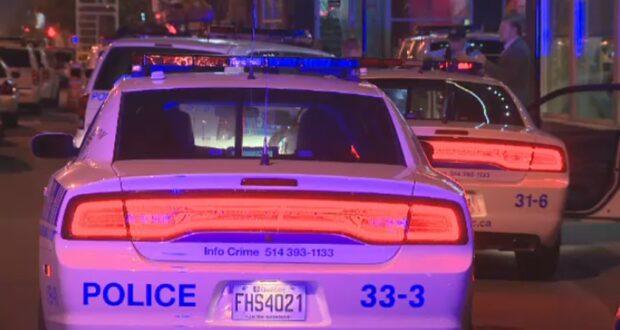 صورة لسيارات شرطة مونتريال في شوارع المدينة حيث شرطة مونتريال توقف سيارة لفحص حظر التجوال والعثور على مخدرات وبندقية فيها