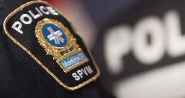صورة شارة الشرطة تظهر خلال مؤتمر صحفي في مونتريال. لتنتقل شرطة مونتريال من باب لآخر في فيردون لجمع معلومات عن جريمة قتل